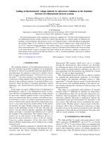 Scaling of thermoelectric voltage induced by microwave radiation at the boundary between two dimensional electron systems