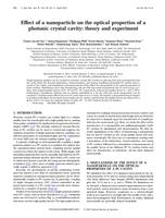 Effect of a nanoparticle on the optical properties of a photonic crystal cavity: Theory and experiment